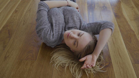 Pretty blonde dance laying on the floor Footage