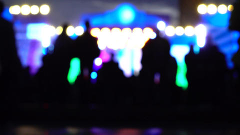 Blurred people heading to night show. 4K background bokeh shot Footage