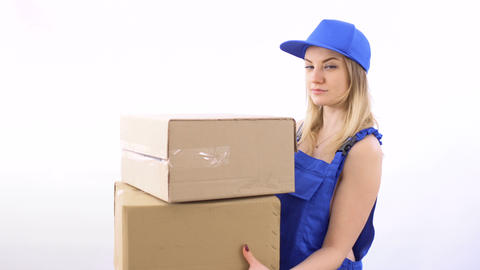 Young naked girl in blue overalls delivers boxes to customer Footage