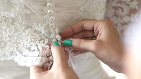 Buttoning wedding dress Footage