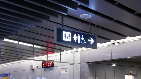 Motion of man and woman washroom logo inside MRT platform with 4k resolution Footage
