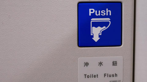 Close up on toilet flush button and push sign in airplane lavatory with 4k Footage