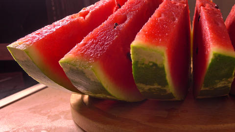 Row of watermelon slices closeup 4K pan shot Footage