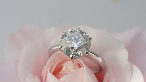 ring with diamonds on a rotating stand rose (close-up) Footage
