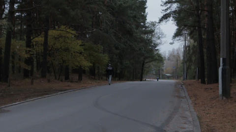 Man Running in the Forest Road 画像