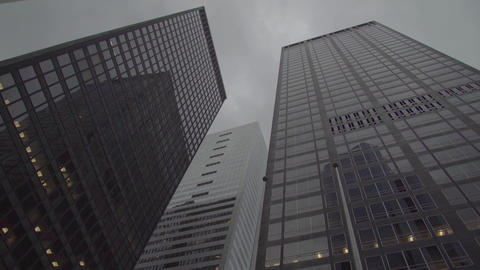 two dark corporate high-rise buildings in New York Footage