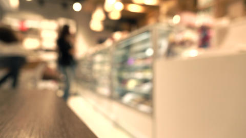Brunette girl choosing chocolates in pastry shop. 4K background bokeh video Footage