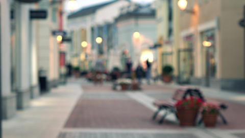 Blurred view of outdoor outlet shopping center. 4K bokeh video Footage