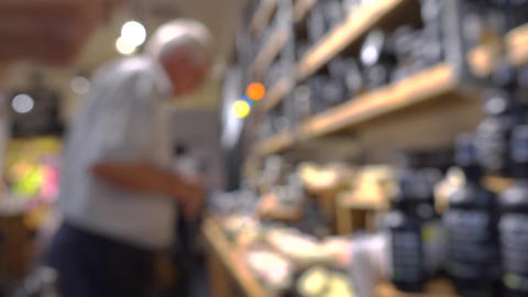 Unrecognizable customers in cosmetics shop. 4K bokeh video Footage