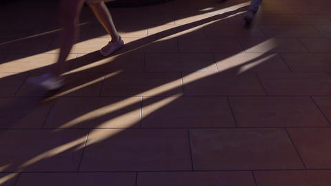 Feet walking on brown floor. 4K video Footage