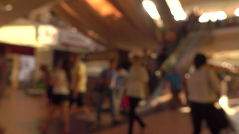 Blurred people on moving staircases in modern shopping center. 4K background Live Action