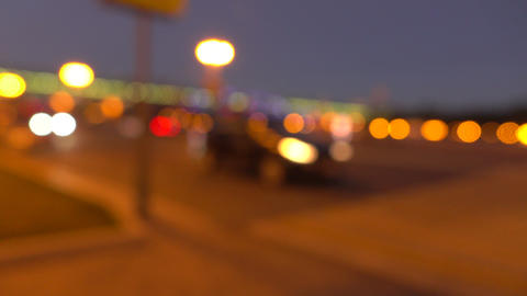 Blurred evening street. Lights and cars. 4K background bokeh shot Footage