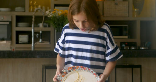 An innocent young girl carrying a plate of spaghetti accidentally spills it on Footage