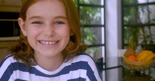 Adorable 10 year old girl smiling and looking at the camera - copy space Footage