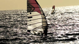 Wind surfers passing by in great wind Footage