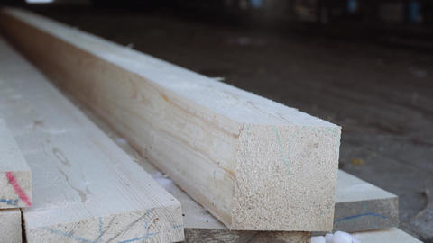 Timber bar on planks stack at sawmill storage Live Action