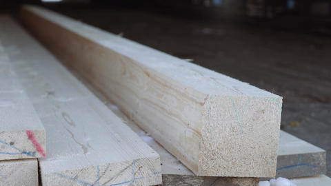 Lumber bar on planks stack at sawmill storage Live Action