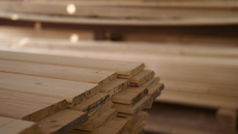 Workers puts stacks of packed lumber plank lying in storage of woodwork facility Footage