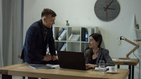 Handsome man flirting with coworker at thr office GIF