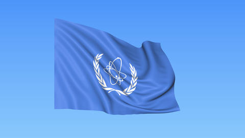 UN International Atomic Energy Agency IAEA flapping flag. Seamless looping, 4K Live Action