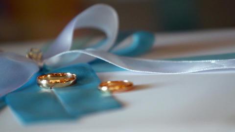 Falling wedding rings Stock Video Footage