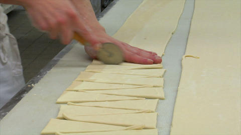 german bakery cuts special pieces of dough 10771 Stock Video Footage