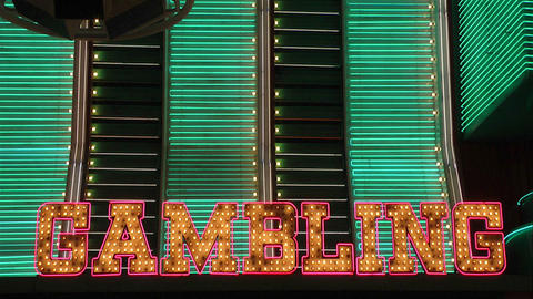 The word Gambling in neon lights Stock Video Footage