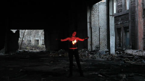 Woman holds in his hand the fire Footage