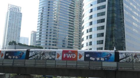 BTS train leaving Chong Nonsi BTS Station in Bangkok Footage