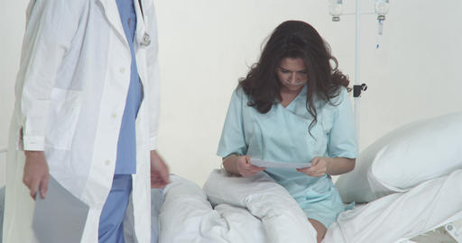Doctor With Patient In Hospital stock footage