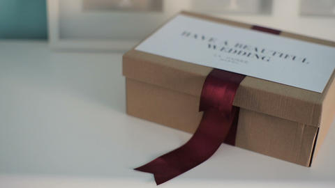 Beautiful wedding box for a gift on a white dresser Footage