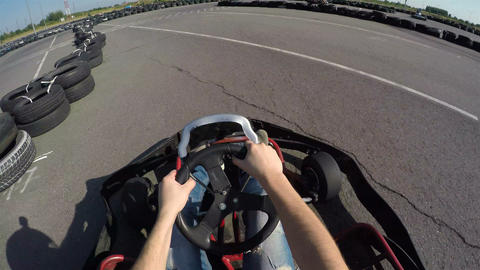 man holds the steering wheel with his hands, Man drives go kart on track, Kartin Footage