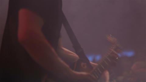 Man playing a guitar at a rock concert. Guitar close up Footage