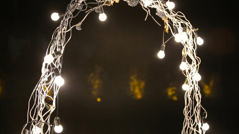 Beautiful evening wedding arch for the ceremony with lights, Live Action