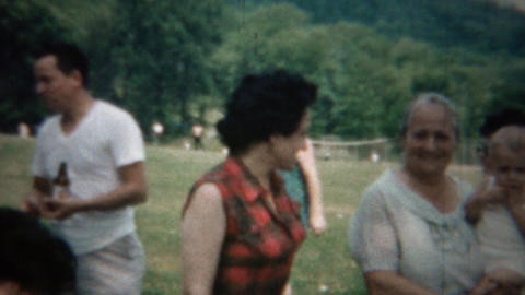 1963: Plaid sleeveless shirt woman outdoor family reunion picnic Footage