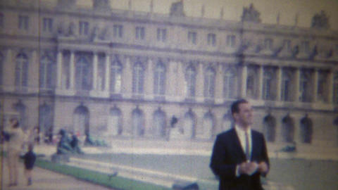 1963: Italian Man Visits Stately Palace Grounds Dressed To Kill stock footage