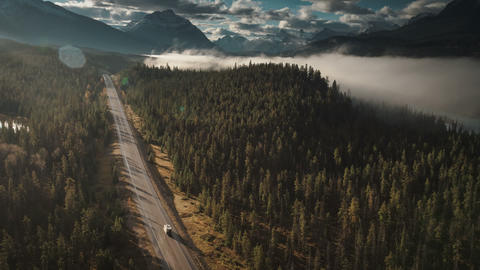 Aerial of rv driving on icefields parkway in jasper birds eye Live Action