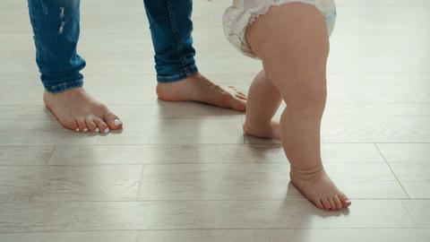 Legs of mother and baby. First steps Footage