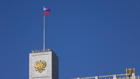 Russian flag and Russian state emblem above government White house in Moscow, 4K Live Action
