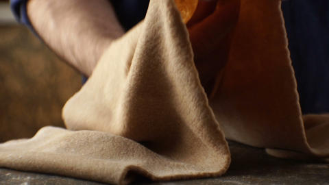 Thin dough for pasta in the hands of a man close-up. Video Footage