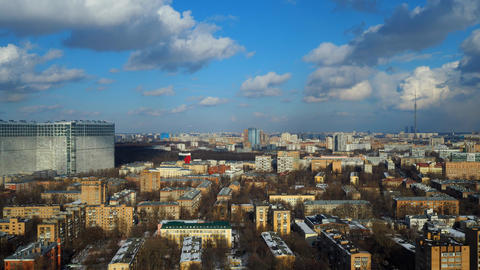 Partly cloudy winter time lapse with distant Ostankino TV tower, Moscow. 4K Footage