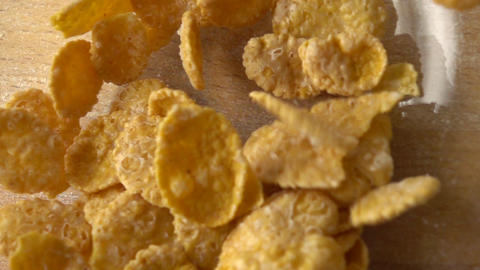 Pouring corn flakes in glass bowl super slow motion macro shot, view from above Footage