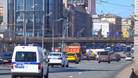 City highway traffic on sunny day 4K shot, Moscow, Russia Footage