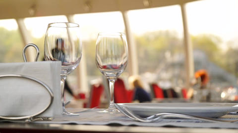 Table with wine glasses in river boat restaurant, Moscow river Live Action