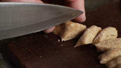 Man cuts the dough to get a paste. Video Archivo