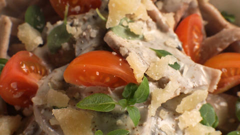 Ready-made pasta with mushroom sauce and cheese close-up. Video Footage