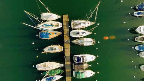 Panorama horizon aerial view water lakesailboats dock pier Live Action