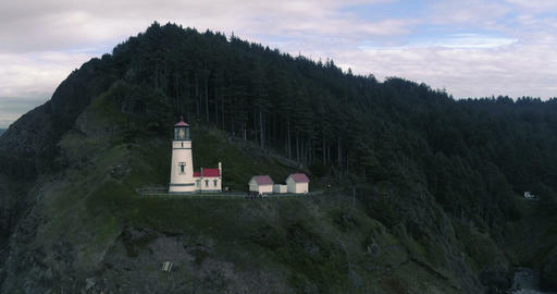 Vivid red heceta head lighthouse overseeing the oregon coast Footage