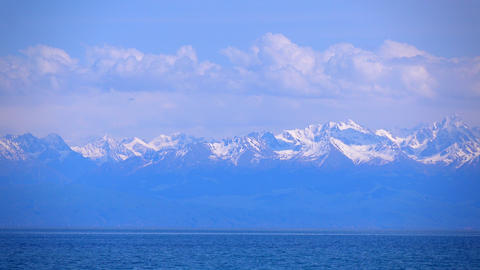 Kyrgyzstan, Issyk Kul lake and snow covered mountains. 4K telephoto lens shot Footage