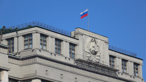 Russian flag above Russian legislative body State Duma. Moscow. 4K video Live Action